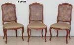 """Oito cadeiras em cerejeira, estilo """"Luis XV"""". Espaldar ondulado e entalhado com flores. Pernas arqueadas e pés de cachimbo. Encosto forrado em palhinha e assento forrado em tecido dourado."""