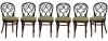 """THONET (Austria - séc. XIX) - Seis cadeiras austríacas em madeira escurecida. Espaldar arredondado com montantes encurvados em volutas. Pernas torneadas. Assento em palhinha. Acompanha almofadas em tecido verde capitonê. Gravado """"Thonet"""" no fundo das cadeiras. Reproduzido com foto no catálogo."""