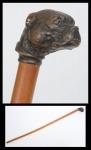 """Bengala em rádica com castão no feitio de """"cabeça de Bull Terrier"""" em bronze patinado. Alemanha - séc. XIX."""