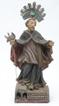 SÃO GONÇALO DO AMARANTE. Imagem em madeira policromada. Alt.: 40,5cm. Acompanham crucifixo e cajado. Brasil - séc. XIX/XX.