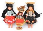 """Três bonecas portuguesas representando """"Minhotas"""". Olhos de vidro em movimento. Vestes e apetrechos típicos. Alt.: 30cm e 23cm. (Década de 70)."""