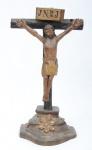 CRISTO CRUCIFICADO. Imagem em madeira policromada. Alt.: 36cm. Minas - séc. XVIII.