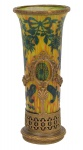 ABEL COMBE PARIS (FRANÇA, FINAL DO SÉC. XIX). Raro vaso art nouveau com influência neo clássica em pasta de vidro, decorado com ramos, vaso de flores e lacinhos de fita nas cores amarelo, laranja, verde e azul. Guarnição em metal dourado filigranado guarnecido com guirlanda de flores, ramos e fitomorfos. Alt.: 18cm. Assinado. (Pequeno restauro na borda). Reproduzido com foto no catálogo. (Em função da fragilidade, este lote só poderá ser enviado para fora do estado através de transportadora especializada).