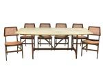 """JOAQUIM TENREIRO (1906-1992). Mesa de jantar dita """"Brasília"""" em jacarandá, década de 60. Estrutura em linhas retas, sendo que as pernas são ligeiramente arqueadas na parte interna inspiradas nas colunas do """"Palácio do Planalto"""". Tampo em mármore bege com rajados acinzentados. Laterais encurvadas. Alt.: 72cm. Medida do tampo: 2,03m x 1,00m. Acompanham 6 cadeiras do mesmo designer em jacarandá ditas """"Assento Curvo"""", década de 60. Encosto e assento encurvados. Pernas torneadas e amarrações em linhas retas. Forração em palhinha. (Três cadeiras com palhinha sintética e 2 assentos necessitando de reparo ). Estas cadeiras encontram-se reproduzidas na pág. 126 do livro """"Tenreiro"""" por Soraia Cals."""
